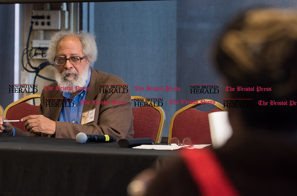 030217 Wesley Bunnell | Staff CCSU held their annual African Studies Conference on Thursday March 2 in Constitution Hall. Dr. John Bracey listens as a member of the audience asks a question at the conclusion of his presentation.