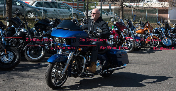 030217 Wesley Bunnell | Staff Salesman Michael Morin of Yankee Harley Davidson in Bristol takes a Road Glide on a test ride on Thursday March 2. The state is currently discussing implementing a mandatory helmet law for all motorcycle riders.