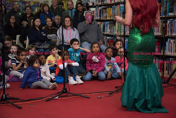 030217 Wesley Bunnell | Staff New Britain High School held a rehearsal for their upcoming performances of The Little Mermaid at the New Britain Public Library on Thursday March 2. Children and parents during the performance.
