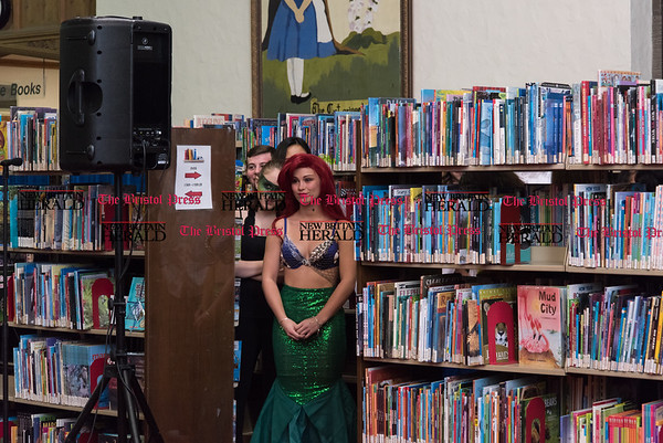 030217 Wesley Bunnell | Staff New Britain High School held a rehearsal for their upcoming performances of The Little Mermaid at the New Britain Public Library on Thursday March 2. Jasmine Colapietro as Ariel waits for her cue.