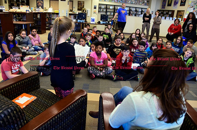 "3/2/2017 Mike Orazzi | Staff West Bristol School's Haley Pilon reads to 4th and 5th grade students during ""Read Across America Day"" in Bristol Thursday."