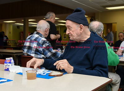 032217  Wesley Bunnell | Staff  Lunch is served for seniors at the New Britain Senior Center on March 22, 2017 as part of the congregate meal program.  Chester Williams ,age 76, sits with friends during lunch.