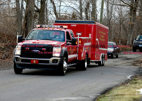 3/29/2017 Mike Orazzi | Staff Members of the Plainville Fire Department leaving the scene on North Mountain Road on the Plainville New Britain line after a missing hiker's body was located late Wednesday afternoon.