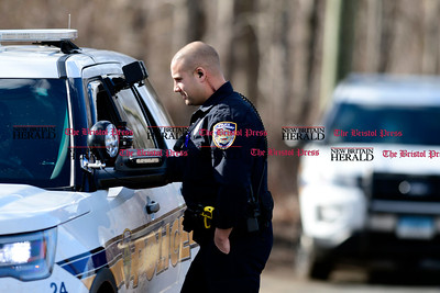 3/29/2017 Mike Orazzi | Staff  Police blocking the entrance to the Metacomet trail on North Mountain Road on the Plainville New Britain line as Connecticut State Police search the area for a missing hiker with dogs and the use of drone Wednesday morning.