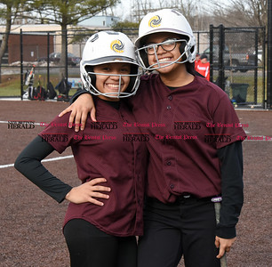 033017  Wesley Bunnell | Staff  New Britain High School softball players wait for their turn at bat in the bottom of the 5th inning during a scrimmage against Cromwell on Thursday afternoon at Chesley Park.