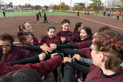 033017  Wesley Bunnell | Staff  New Britain High School softball prior to the bottom of the 5th inning during a scrimmage against Cromwell on Thursday afternoon at Chesley Park.