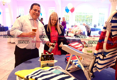 3/30/2017 Mike Orazzi | Staff Leon and Mary Grabeline bid on a beach chair complete with beer during the silent auction at the United Way of Southington's Annual Meeting held at the Aqua Turf Club in Southington Thursday night.