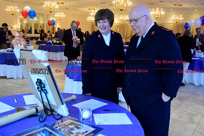 3/30/2017 Mike Orazzi | Staff Salvation Army representatives Carol and Roger Duperree look over silent auction items during the United Way of Southington's Annual Meeting held at the Aqua Turf Club in Southington Thursday night.