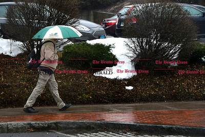 3/31/2017 Mike Orazzi | Staff A man walks under an umbrella on North Main Street Friday.