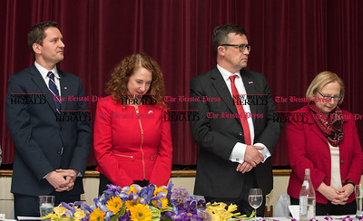 033117  Wesley Bunnell | Staff  Polish Ambassador Piotr Wilczek visited New Britain's Little Poland section on Friday March 31, 2017 to celebrate the opening of an honorary Polish Consul in the city. Heads bowed during prayer are honorary Consul Darek Barcikowski, Congresswoman Elizabeth Esty, Ambassador Piotr Wilczek and State Senator Terry Gerratana.