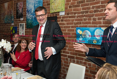 033117  Wesley Bunnell | Staff  Polish Ambassador Piotr Wilczek visited New Britain's Little Poland section on Friday March 31, 2017 to celebrate the opening of an honorary Polish Consul in the city. From left, former Mayor Lucian Pawlak, Congresswoman Elizabeth Esty, Senator Richard Blumenthal applaud as Ambassador Piotr Wilczek is introduced by honorary Consul Darek Barcikowski, right, during a luncheon at Belvedere Restaurant.