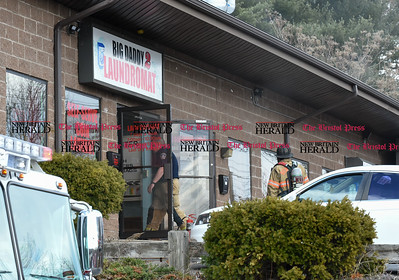 030317  Wesley Bunnell | Staff  A fire official enters the Big Daddy 2 Laundromat on Friday March 3 after crews were finished with the fire.