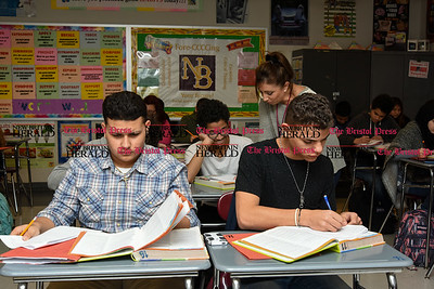 030717  Wesley Bunnell | Staff  Izeiha Rodriguez, left sits with Luis Burgos in Mrs. Rogers health class in New Britain High School's Freshman Academy on March 7 as Mrs. Rogers helps a student in the background.