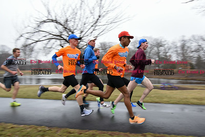 030717  Wesley Bunnell | Staff  Julio Arredondo , second from the front, along with teammates from CCSU's Track & Field team perform speed play running exercises at Stanley Quarter Park on Tuesday March 7.