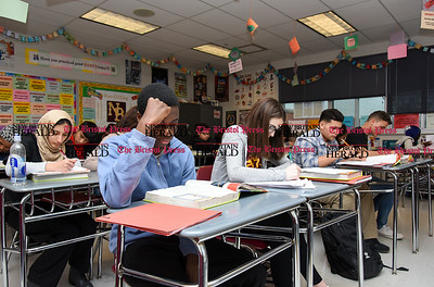 030717  Wesley Bunnell | Staff  David Akinwole sits next to Morgan Giantonio in the front row in Mrs. Rogers health class in New Britain High School's Freshman Academy on Tuesday March 7.