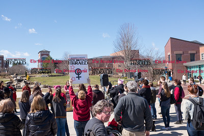 030817  Wesley Bunnell | Staff  A rally was held on CCSU's campus in solidarity with the International Women's Strike at noon on Wed March 8. Professor Kristine Larsen holds a sign of support for the protest as Chairperson of the event as Amy Frances Tenenbaum speaks at the podium. Larsen has been a professor of Astronomy at CCSU since 1989 while Tenenbaum is majors in the Women, Gender & Sexuality Studies Program.