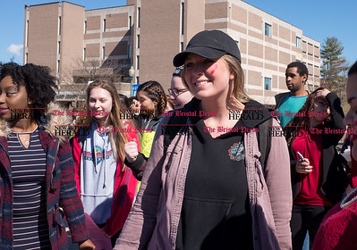 030817  Wesley Bunnell | Staff  A rally was held on CCSU's campus in solidarity with the International Women's Strike at noon on Wed March 8. Junior Olivia Doolan receives a red lipstick mark and safety pin in a further show of solidarity with the rally organizers.