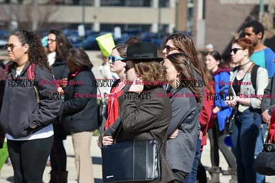 030817  Wesley Bunnell | Staff  A rally was held on CCSU's campus in solidarity with the International Women's Strike at noon on Wed March 8. Sophomore English Major Mason Quinn stands with the crowd during the rally.