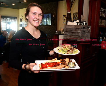 3/8/207 Mike Orazzi | Staff Cafe 2 North's Sarina Goulet while serving customers in Wolcott.