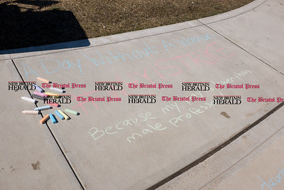 030817  Wesley Bunnell | Staff  A rally was held on CCSU's campus in solidarity with the International Women's Strike at noon on Wed March 8. Participants took the opportunity to use chalk to write messages of equality and support during the rally.