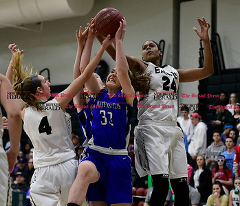3/9/2017 Mike Orazzi | Staff Southington's Janette Wodolowski (33) between Enfield's Erica Lovering (4) and Mary Baskerville (24) in the Class LL Quarterfinal in Enfield Thursday night.