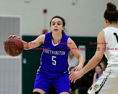 3/9/2017 Mike Orazzi | Staff Southington's Margaret Meehan (5) and Enfield's Caterina Fonseca (14) in the Class LL Quarterfinal in Enfield Thursday night.