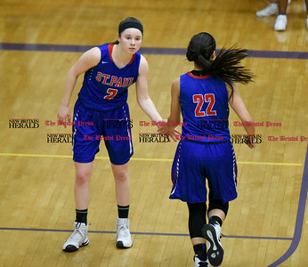 030917  Wesley Bunnell | Staff  St. Paul's girls basketball was defeated by Career Magnet in a Class M CIAC playoff game played at Career High School in New Haven on March 9. Guard Captain Brigid Johndrow (2) with Forward Amelia Sanchez (22) after a basket.