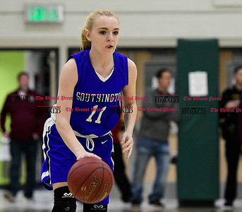 3/9/2017 Mike Orazzi | Staff Southington's Kristen Longley (11) in the Class LL Quarterfinal in Enfield Thursday night.