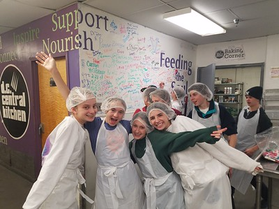 Seventh and Eighth Graders Spend Their Weekend Helping Others