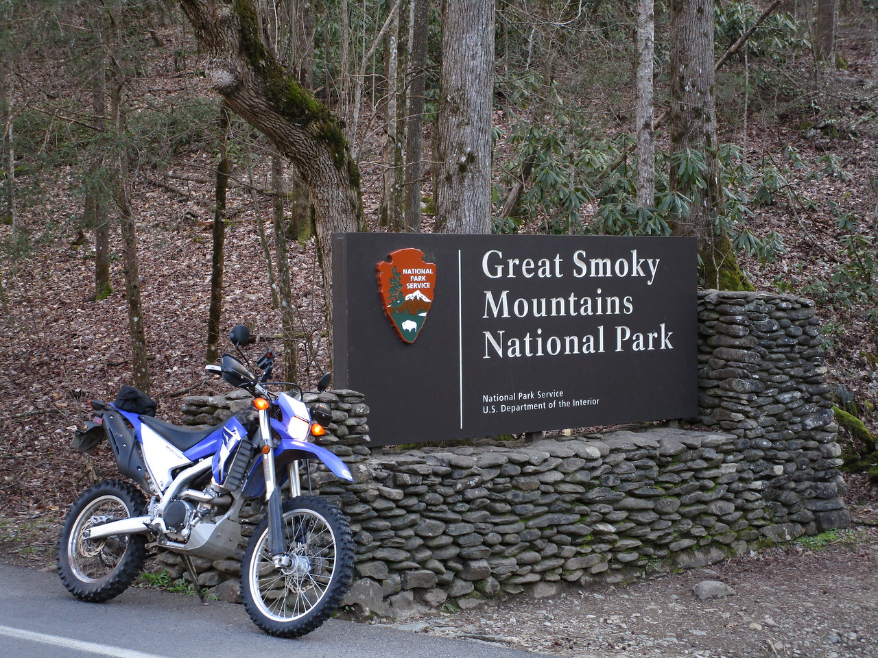 "I really like taking a picture of my machine with signs.  I don't know what my deal is.  Pictured here: my motorcycle and a sign that says ""Great Smoky Mountains National Park"".  I was there, damnit!  The sign proves it."