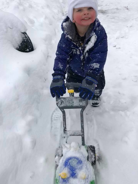 ". This little helper is ""mowing\"" the snow on Friday, March 2, 2018, in this photo by Erika Mae."