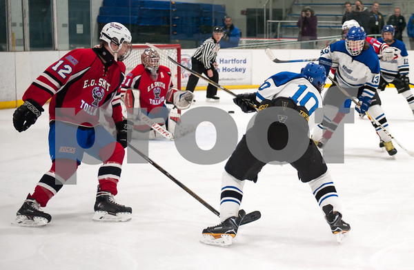03/01/18 Wesley Bunnell | Staff Hall-Southington defeated EO Smith-Tolland 4-3 in the CCC South semi-final game on Thursday at Veterans Memorial Rink in West Hartford. Michael DiPietro (10) shoots and scores.