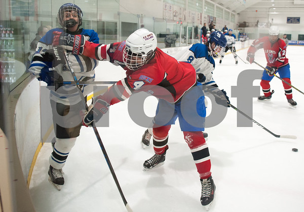 03/01/18 Wesley Bunnell | Staff Hall-Southington defeated EO Smith-Tolland 4-3 in the CCC South semi-final game on Thursday at Veterans Memorial Rink in West Hartford. Miles Aranow (12) and Jason Franklin (4).