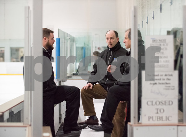 03/01/18 Wesley Bunnell | Staff Hall-Southington defeated EO Smith-Tolland 4-3 in the CCC South semi-final game on Thursday at Veterans Memorial Rink in West Hartford. Head Coach Brian Cannon speaks with his assistant coaches.