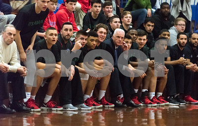 03/05/18  Wesley Bunnell | Staff  St. Paul basketball vs Joel Barlow on Monday night at St. Paul High School. Head Coach Steve Phelps sits in the middle of the bench watching the action.