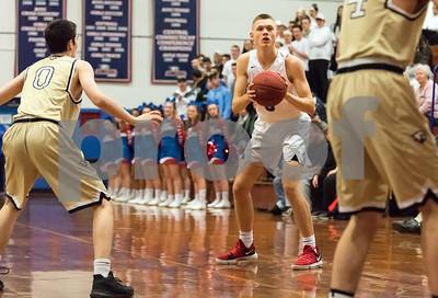 03/05/18  Wesley Bunnell | Staff  St. Paul basketball vs Joel Barlow on Monday night at St. Paul High School. Matthew Garry (3)