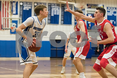03/05/18  Wesley Bunnell | Staff  Southington basketball defeated Berlin on Monday night at Southington High School in a first round state tournament game. Andrew Lohneiss (35) guarded by Mike McCarthy (33)