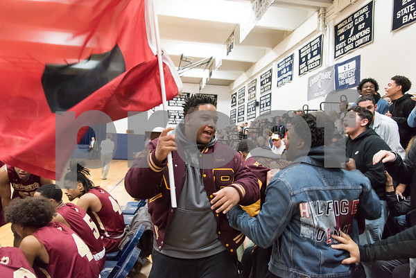 03/12/18 Wesley Bunnell | Staff New Britain basketball vs Immaculate at Immaculate High School on Monday night. Student Devon Bishop waves a hurricane flag at the beginning of the game.