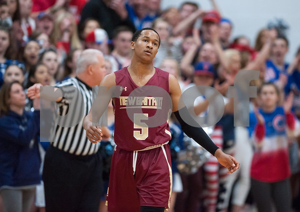 03/12/18 Wesley Bunnell | Staff New Britain basketball was eliminated from the Division II state tournament with a 56-41 loss to Immaculate in a game played at Immaculate on Monday night. Maurice Turner (5) reacts to an officials call as the student section for Immaculate is seen behind.