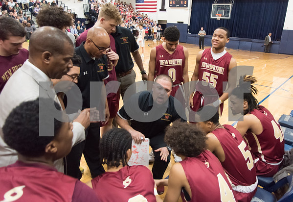 03/12/18 Wesley Bunnell | Staff New Britain basketball vs Immaculate at Immaculate High School on Monday night. Head coach Kurt Reis addresses the team at the beginning of the game.