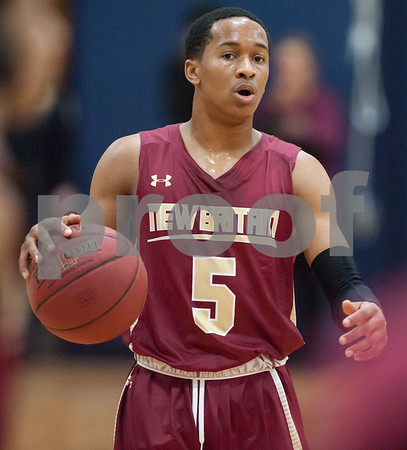 03/12/18 Wesley Bunnell | Staff New Britain basketball was eliminated from the Division II state tournament with a 56-41 loss to Immaculate in a game played at Immaculate on Monday night. Thameen Dupree (5).
