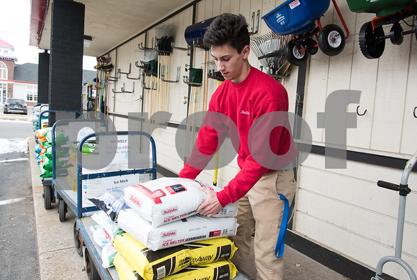 03/12/18 Wesley Bunnell | Staff Jake Porowoski stocks the last of the ice melt at City True Value Hardware in Bristol on Monday afternoon in preparation for the upcoming storm. Snow supplies are in short supply after a big rush before last weeks nor'easter.