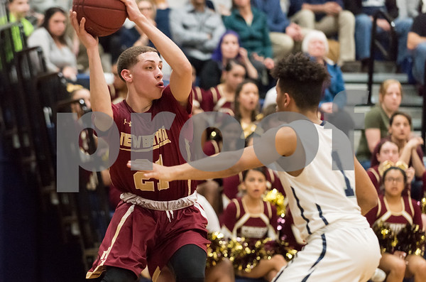 03/12/18 Wesley Bunnell | Staff New Britain basketball was eliminated from the Division II state tournament with a 56-41 loss to Immaculate in a game played at Immaculate on Monday night. Nyzaiah Diaz (21).