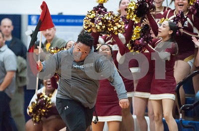 03/12/18  Wesley Bunnell | Staff  New Britain basketball was eliminated from the Division II state tournament with a 56-41 loss to Immaculate in a game played at Immaculate on Monday night. Student Devon Bishop runs with a hurricane warning flag past the New Britain cheerleaders.