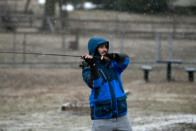 3/21/2018 Mike Orazzi | Staff Leo Leoveanu while fishing at Pine Lake Wednesday in Forestville as the snow begins to fall.