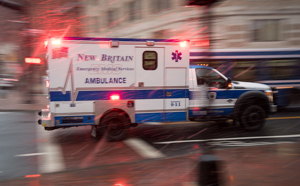 03/21/18 Wesley Bunnell   Staff A New Britain EMS ambulance heads down Main St responding to call during the beginning of snow flurries on Wednesday evening. The expected nor'easter started late in the day on Wednesday after many businesses and schools closed early for the day.