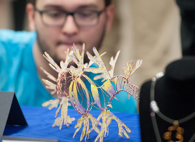 03/27/18  Wesley Bunnell | Staff  In honor of March being Youth Art Month, Berlin High School AP Studio Art is holding a showing of student work beginning on Monday, March 26th running through Friday, March 30th at the Berlin Peck Library. BHS Senior Xavier Montanez leans over for a close up look at a sculpture titled Leafy Sea Dragon by Rebecca Soderberg.
