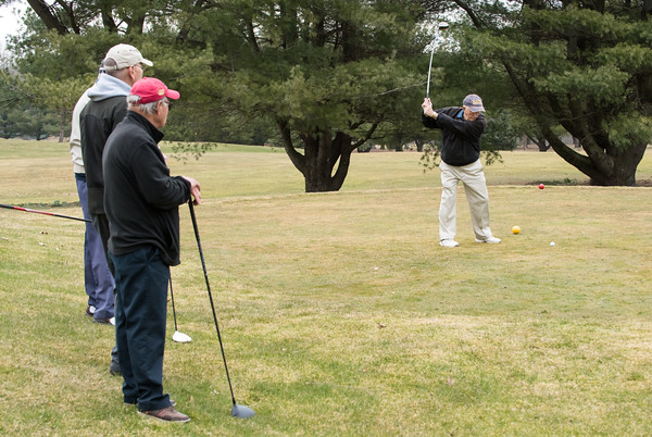 03/29/18 Wesley Bunnell | Staff Charlie Rozanski tees off on opening day at Stanley Golf Course on Thursday morning as stand aside.