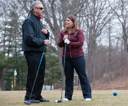 03/29/18 Wesley Bunnell | Staff Mayor Erin Stewart speaks with Chairman of the Parks and Recreation Commission Patrick Dorsey before Stewart hit the ceremonial first ball on the first tee on opening day at Stanley Golf Course on Thursday morning.
