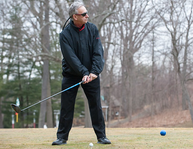 03/29/18  Wesley Bunnell | Staff  Chairman of the Parks and Recreation Commission Patrick Dorsey prepares to hit his tee shot after Mayor Erin Stewart on opening day at Stanley Golf Course on Thursday morning.